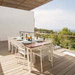 Outdoor dining with sunset sea view